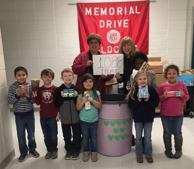 Memorial Drive students shown with donations